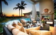 luxurious-living-room,-pool,-fireplace,-palm-trees-151544